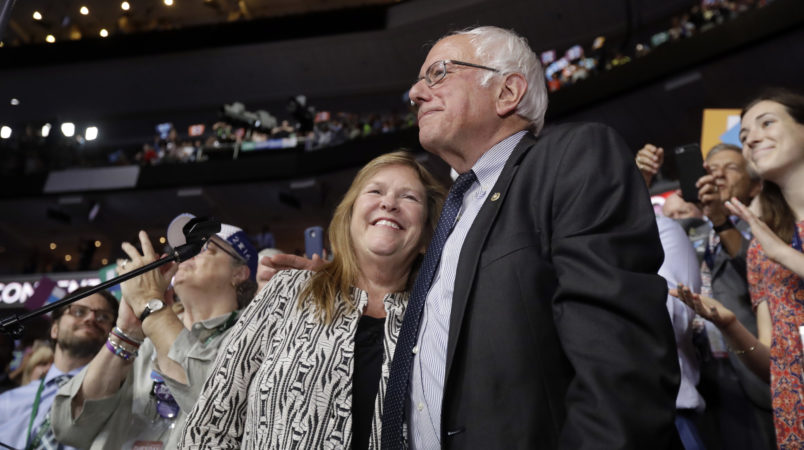 Former Democratic presidential candidate, Sen. Bernie Sanders, I-Vt., hugs wife Jane after standing with the Vermont delegation and asking that Hillary Clinton become the unanimous choice for President of the United States during the second day of the Democratic National Convention in Philadelphia , Tuesday, July 26, 2016. (AP Photo/Matt Rourke)