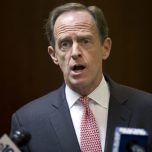 """Sen. Pat Toomey, R-Pa., speaks with members of the media during a news conference, Monday, May 9, 2016, in Philadelphia.  Toomey calls on Philadelphia to end its """"sanctuary city"""" policy and begin cooperating with federal law enforcement officers in helping them find immigrants in the country illegally who are suspected of violent crimes. (AP Photo/Matt Rourke)"""
