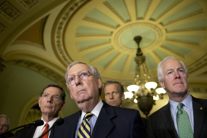 Sen. John Barrasso, R-Wyo., left, Majority Leader Mitch McConnell, from Kentucky, Sen. John Thune, R-S.D., and Republican Whip Sen. John Cornyn, R-Texas, listen to a question after their policy luncheon, on Capitol Hill, Tuesday, June 21, 2016 in Washington. (AP Photo/Alex Brandon)