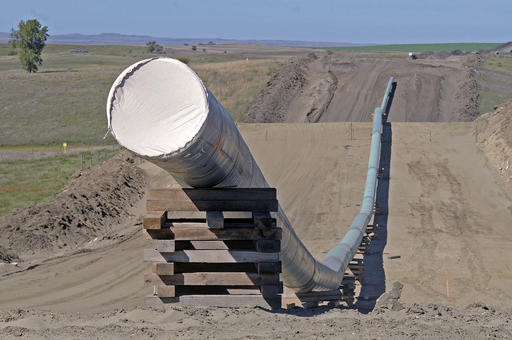 FILE - In this Sept. 29, 2016, file photo, shows a section of the Dakota Access Pipeline under construction  near the town of St. Anthony in Morton County, N.D. Texas-based Energy Transfer Partners, the company building the oil pipeline, asked a a federal judge on Tuesday, Jan. 17, 2017, to block the U.S. Army Corps of Engineers from launching a full environmental study of the $3.8 billion pipeline's disputed crossing of a Missouri River reservoir in North Dakota. (Tom Stromme/The Bismarck Tribune via AP, File)
