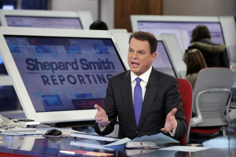 """Fox News Channel chief news anchor Shepard Smith broadcasts from The Fox News Deck during his """"Shepard Smith Reporting"""" program, in New York, Monday, Jan. 30, 2017. (AP Photo/Richard Drew)"""