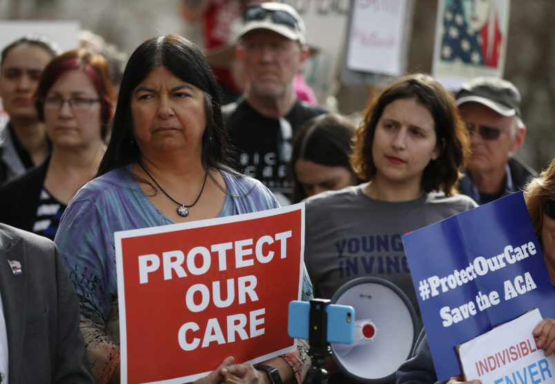 State Sen. Dr. Irene Aguilar, D-Denver, left, stands with activist Christina Postolowski, of the group Young Invincibles, as supporters of the Affordable Care Act who are also opponents of Colorado's GOP-led plan to undo Colorado's state-run insurance exchange hold a rally on the state Capitol steps in Denver, Tuesday, Jan. 31, 2017. The state GOP measure, a bill which would dismantle Connect For Health Colorado within a year, is an indication of how Republicans plan to chip away at Obamacare. If the federal health care law remains unchanged, it would force Coloradans shopping for private insurance to use the federal exchange. (AP Photo/Brennan Linsley)