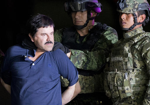"FILE - In this Jan. 8, 2016 file photo, a handcuffed Joaquin ""El Chapo"" Guzman is made to face the press as he is escorted to a helicopter by Mexican soldiers and marines at a federal hangar in Mexico City. Mexican President Enrique Pena Nieto announced Guzman was recaptured six months after escaping from a maximum security prison. (AP Photo/Eduardo Verdugo, File)"