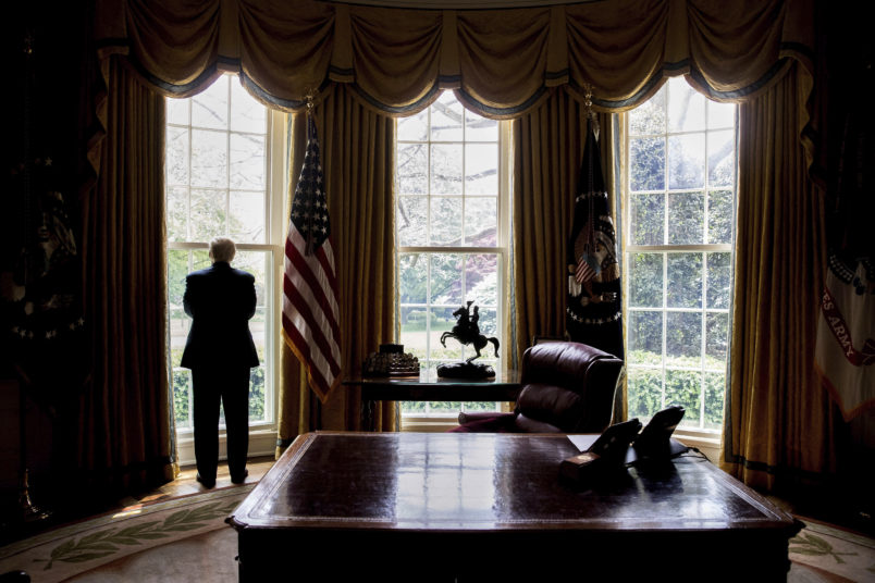 HOLD FOR STORY: TRUMP 100-EDUCATION OF DONALD TRUMP -- President Donald Trump looks out an Oval Office window at the White House after an Associated Press interview Friday, April 21, 2017 in Washington. (AP Photo/Andrew Harnik)