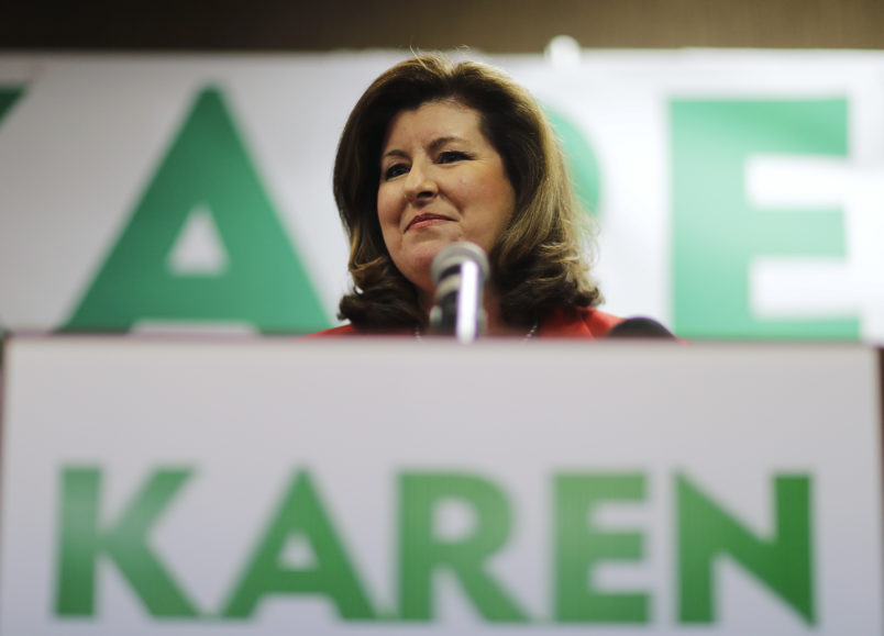 Republican candidate for Georgia's Sixth Congressional seat Karen Handel updates supporters on early results at an election night watch party in Roswell, Ga., Tuesday, April 18, 2017. Republicans are bidding to prevent a major upset in a conservative Georgia congressional district Tuesday where Democrats stoked by opposition to President Donald Trump have rallied behind a candidate who has raised a shocking amount of money for a special election. (AP Photo/David Goldman)