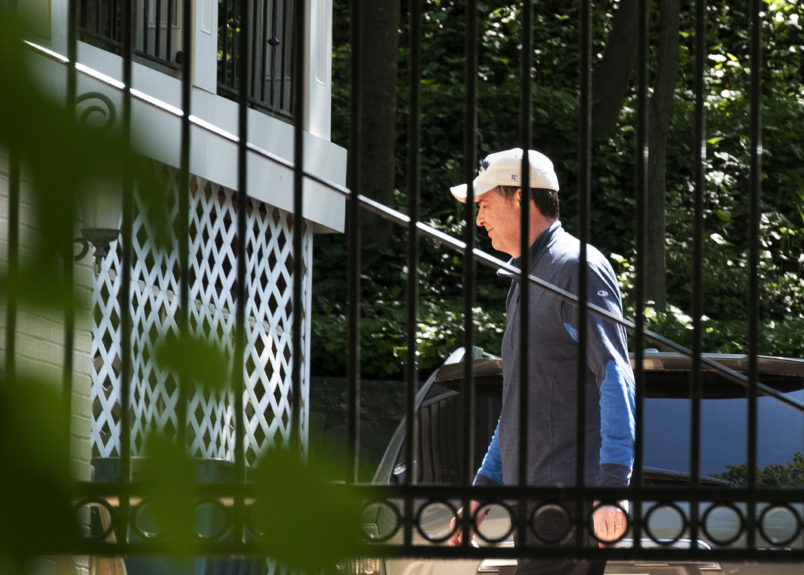 Former FBI Director James Comey walks at his home in McLean, Va., Wednesday, May 10, 2017. President Donald Trump fired Comey on Tuesday, ousting the nation's top law enforcement official in the midst of an investigation into whether Trump's campaign had ties to Russia's election meddling. (AP Photo/Sait Serkan Gurbuz)