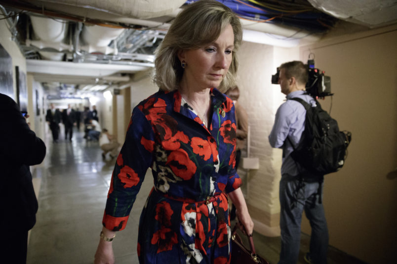 "Rep. Barbara Comstock of Virginia, whose constituents live in the northern Virginia suburbs outside Washington, heads to a closed-door strategy session with Speaker of the House Paul Ryan, R-Wis., and the leadership as they try to rebuild unity within the Republican Conference, at the Capitol, in Washington, Tuesday, March 28, 2017.  Rep. Comstock is a key moderate Republican who intended to vote ""no"" on the Republican health care bill that was derailed last week. (AP Photo/J. Scott Applewhite)"