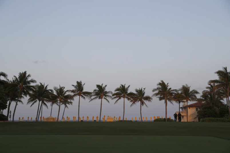 Palm trees are seen across a lawn at Mar-a-Lago where President Donald Trump and Chinese President Xi Jinping are meeting, Thursday, April 6, 2017, in Palm Beach, Fla. (AP Photo/Alex Brandon)