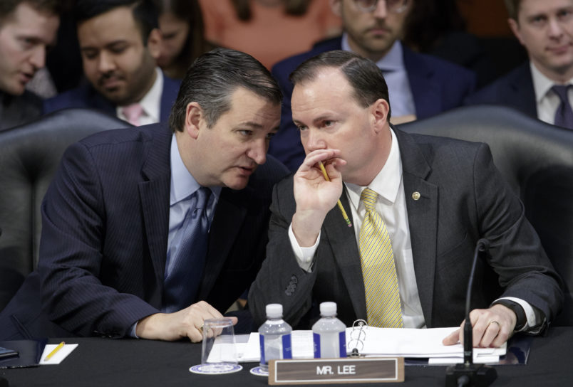 Conservative members of the Senate Judiciary Committee, Sen. Ted Cruz, R-Texas, left, and Sen. Mike Lee, R-Utah, confer as the Republican-led panel meets to advance the nomination of President Donald Trump's Supreme Court nominee Neil Gorsuch to fill the vacancy left by the late Antonin Scalia, on Capitol Hill in Washington, Monday, April 3, 2017.  A weeklong partisan showdown is expected as Democrats are steadily amassing the votes to block Judge Gorsuch and force Republicans to unilaterally change long-standing rules to confirm him.   (AP Photo/J. Scott Applewhite)
