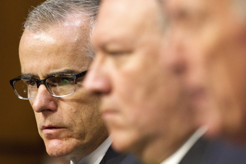Acting FBI Director Andrew McCabe, left, next to CIA Director Mike Pompeo, listens as Director of National Intelligence Dan Coats testifies at a Senate Intelligence Committee hearing, on Capitol Hill in Washington, Thursday, May 11, 2017. It is an annual hearing about the major threats facing the U.S., but former FBI Director Jim Comey's sudden firing is certain to be a focus of questions. (AP Photo/Jacquelyn Martin)