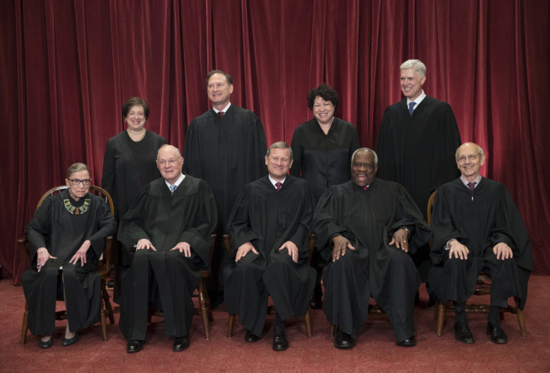 The justices of the U.S. Supreme Court gather for an official group portrait to include new Associate Justice Neil Gorsuch, top row, far right, at the Supreme Court Building in Washington, Thursday. June 1, 2017. Seated in bottom row are, from left, Associate Justice Ruth Bader Ginsburg, Associate Justice Anthony M. Kennedy, Chief Justice of the United States John G. Roberts, Associate Justice Clarence Thomas, and Associate Justice Stephen Breyer. Standing in top row are, from left, Associate Justice Elena Kagan, Associate Justice Samuel Alito Jr., Associate Justice Sonia Sotomayor, and Associate Justice Neil Gorsuch. (AP Photo/J. Scott Applewhite)