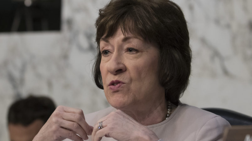 """Sen. Susan Collins, R-Maine, listens as fired FBI director James Comey recounts a series of conversations with President Donald Trump as he testifies before the Senate Select Committee on Intelligence, on Capitol Hill in Washington, Thursday, June 8, 2017. Comey alleges Trump repeatedly pressed him for his """"loyalty"""" and directly pushed him to """"lift the cloud"""" of investigation by declaring publicly the president was not the target of the probe into his campaign's Russia ties.   (AP Photo/J. Scott Applewhite)"""