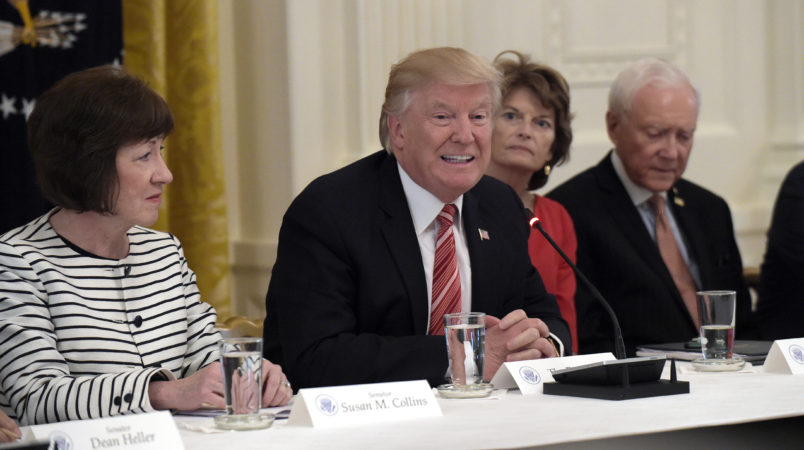 President Donald Trump, center, speaks as he meets with Republican senators on health care in the East Room of at the White House in Washington, Tuesday, June 27, 2017. Seated with him, from left, are Sen. Susan Collins, R-Maine, Sen. Lisa Murkowski, R-Alaska, and Sen. Orrin Hatch, R-Utah. (AP Photo/Susan Walsh)