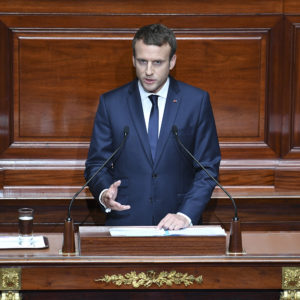 French President Emmanuel Macron speaks during a special congress gathering both houses of parliament (National Assembly and Senate) in the palace of Versailles, outside Paris, Monday, July 3, 2017. Macron will lay out his political, security and diplomatic priorities at an extraordinary joint session of parliament at the chateau of Versailles. (Eric Ferferberg/Pool Photo via AP)