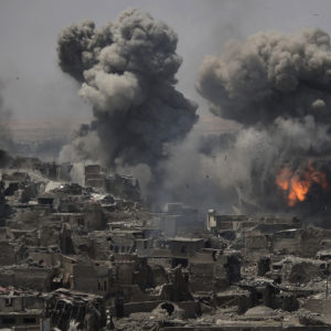 """*** Alternative crop os XFD101 *** Airstrikes continue to target Islamic State positions on the edge of the Old City a day after Iraq's prime minister declared """"total victory"""" in Mosul, Iraq, Tuesday, July 11, 2017. (AP Photo/Felipe Dana)"""