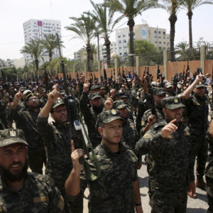 Officers from Hamas national security force chant Islamic slogans while holding their rifles up during a parade against Israeli arrangements in the contested Jerusalem shrine, in front of the Palestinian Legislative Council in Gaza City, Wednesday, July 26, 2017. A senior Muslim official in Jerusalem said Wednesday that worshippers would not return to the contested shrine until Israel removes the new railings and cameras it installed after a deadly attack there. (AP Photo/Adel Hana)