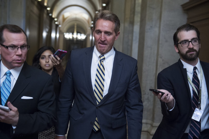 UNITED STATES - JULY 13: Sen. Jeff Flake, R-Ariz., talks with reporters in the Capitol after a meeting where Senate Republicans' unveiled and updated health care bill on July 13, 2017. (Photo By Tom Williams/CQ Roll Call)
