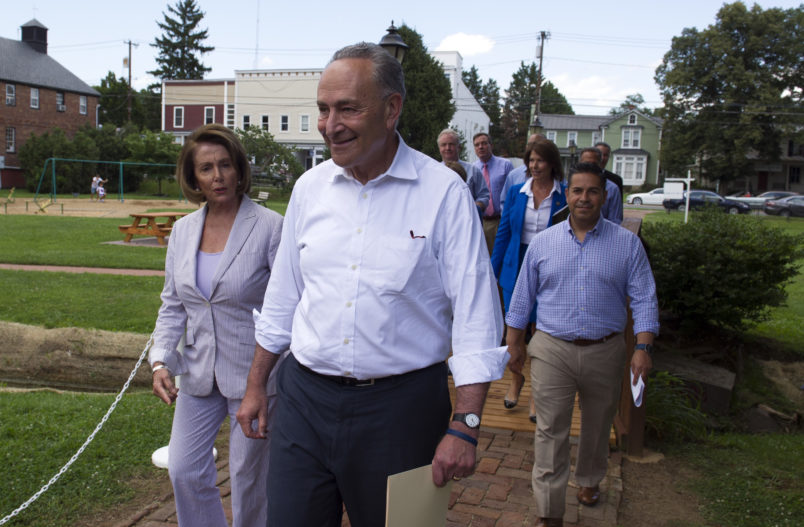 """Senate Minority Leader Chuck Schumer of N.Y. and House Minority Leader Nancy Pelosi of Calif. lead Congressional Democrats to a news conference to unveil their new agenda, Monday, July 24, 2017, in Berryville, Va. House and Senate Democrats are offering a retooled message and populist agenda, promising to working Americans """"someone has your back.""""  (AP Photo/Cliff Owen)"""