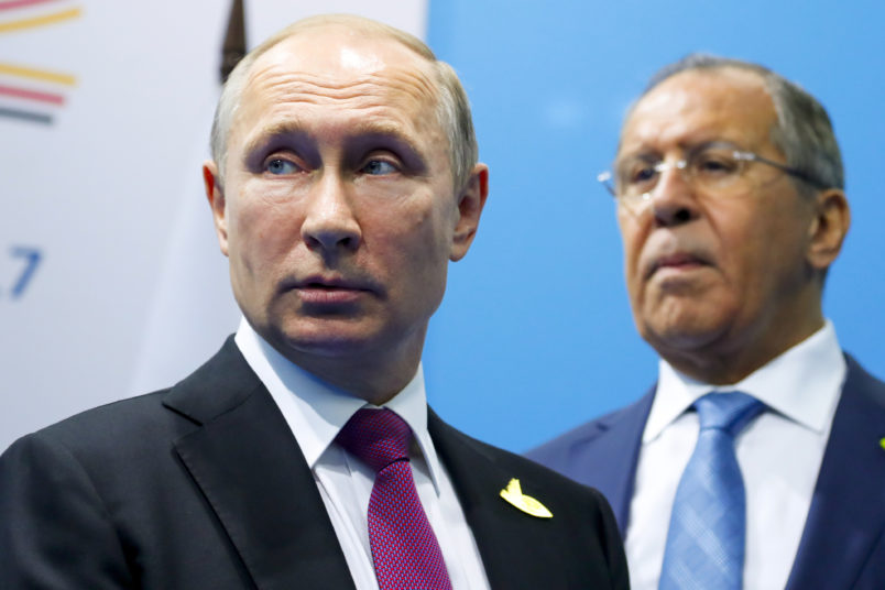 Russian President Vladimir Putin, left, and Foreign Minister Sergey Lavrov stand while waiting for Turkish President Recep Tayyip Erdogan prior to their talks at the G-20 summit in Hamburg, northern Germany, Saturday, July 8, 2017.  (AP Photo/Alexander Zemlianichenko, Pool)