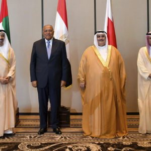 In this Sunday, July 30, 2017 photo released by Bahrain News Agency, from left to right, Foreign Ministers of UAE Abdullah bin Zayed al-Nahyan, Egypt's Sameh Shoukry, Bahrain's Khalid bin Ahmed al-Khalifa and Saudi's Adel al-Jubeir, pose for a photo during their meeting in Manama, Bahrain. Four Arab states that cut ties with Qatar met Sunday to discuss the diplomatic crisis, insisting on compliance with a list of sweeping demands while refraining for now from imposing more punitive measures against the Gulf state. (Bahrain News Agency via AP)