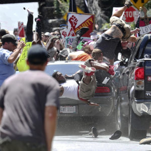 A vehicle plows into a group of protesters marching along 4th Street NE at the Downtown Mall in Charlottesville on the day of the Unite the Right rally on Saturday, August 12, 2017. Photo/Ryan M. Kelly/The Daily Progress