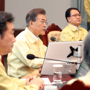 South Korean President Moon Jae-in, center, presides over a cabinet meeting at the presidential Blue House in Seoul, South Korea, Monday, Aug. 21, 2017. U.S. and South Korean troops have begun annual drills that come after tensions rose over North Korea's two intercontinental ballistic missile tests last month. South Korea's President Moon Jae-in said Monday the drills are defensive in nature. He says the drills are held regularly because of repeated provocations by North Korea. (Kim Ju-hyung/Yonhap via AP)