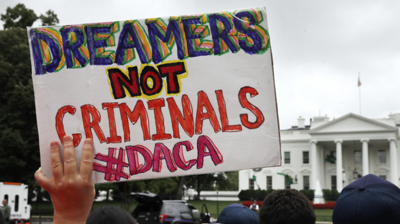 A woman holds up a signs in support of the Obama administration program known as Deferred Action for Childhood Arrivals, or DACA, during an immigration reform rally, Tuesday, Aug. 15, 2017, at the White House in Washington. The Trump administration has said it still has not decided the program's fate. (AP Photo/Jacquelyn Martin)