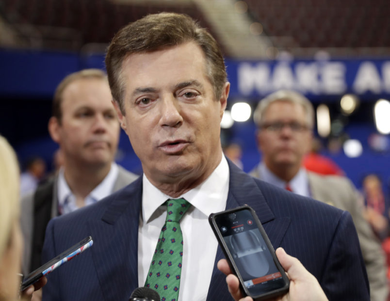 FILE - In this July 17, 2016 file photo, Trump Campaign Chairman Paul Manafort talks to reporters on the floor of the Republican National Convention at Quicken Loans Arena, Sunday, in Cleveland.  Republican Donald Trump announced a shakeup of his campaign leadership Wednesday, the latest sign of tumult in his bid for the White House as his poll numbers slip and only 82 days remain before the election.   (AP Photo/Matt Rourke)
