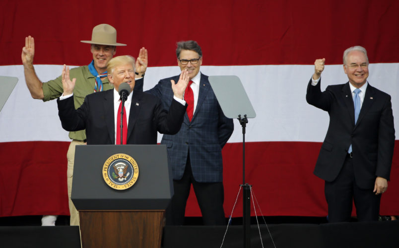 President Trump, front left, gestures as former boys scouts, Ryan Zinke, left, Secretary of Interior, Rick Perry, Secretary of Energy,  center, and Tom Price Secretary of Health and Human Services, right,  at the 2017 National Boy Scout Jamboree at the Summit in Glen Jean,W. Va., Monday, July 24, 2017.  (AP Photo/Steve Helber)