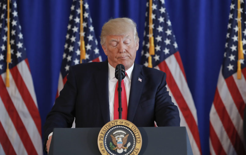 President Donald Trump pauses as he speaks to members of the media regarding the on going situation in Charlottesville, Va., Saturday, Aug. 12, 2017 at Trump National Golf Club in Bedminister, N.J. (AP Photo/Pablo Martinez Monsivais)