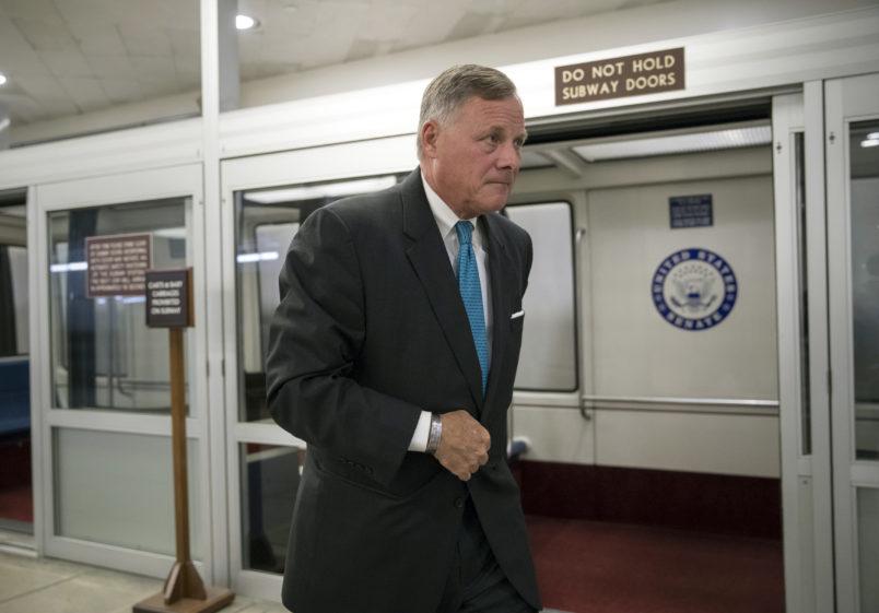 Sen. Richard Burr, R-N.C., chairman of the Senate Select Committee on Intelligence, rushes through a subway corridor at the Capitol in Washington, Tuesday, Sept. 19, 2017.   (AP Photo/J. Scott Applewhite)