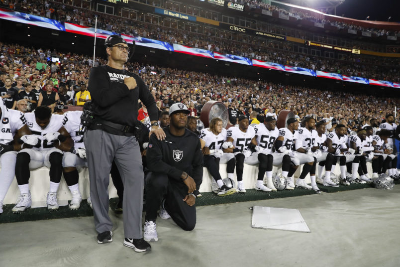 Some members of the Oakland Raiders sits on the bench during the playing of the National Anthem before an NFL football game against the Washington Redskins in Landover, Md., Sunday, Sept. 24, 2017. (AP Photo/Alex Brandon)
