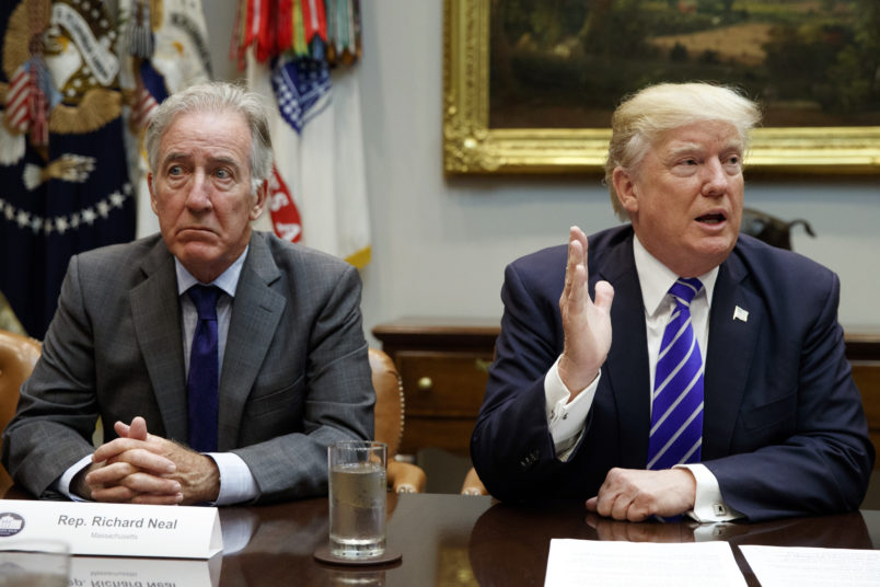 Rep. Richard Neal, D-Mass., listens as President Donald Trump speaks during a meeting with members of the House Ways and Means committee in the Roosevelt Room of the White House, Tuesday, Sept. 26, 2017, in Washington. (AP Photo/Evan Vucci)