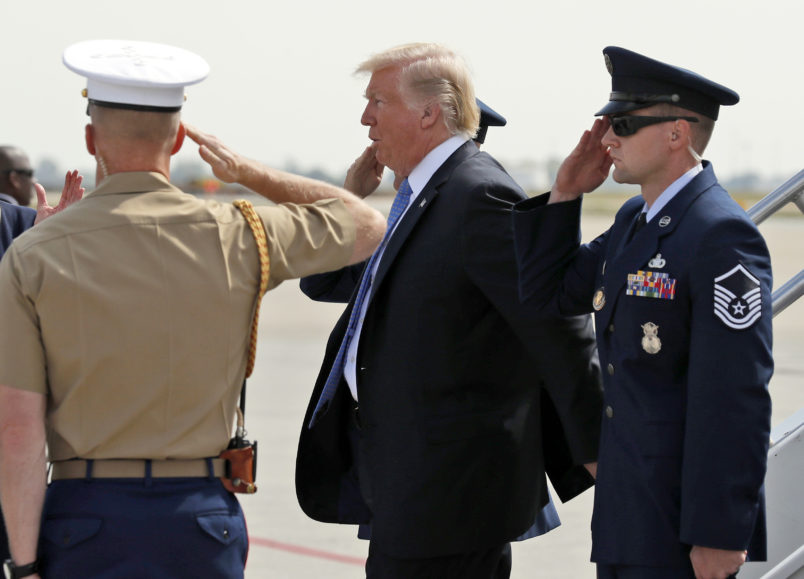 President Donald Trump is saluted as he steps off Air Force One, Wednesday, Sept. 27, 2017, in Indianapolis, Ind. (AP Photo/Alex Brandon)