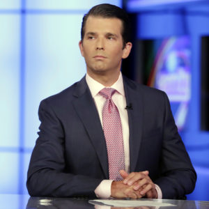Donald Trump Jr. is interviewed by host Sean Hannity on his Fox News Channel television program, in New York Tuesday, July 11, 2017. Donald Trump Jr. eagerly accepted help from what was described to him as a Russian government effort to aid his father's campaign with damaging information about Hillary Clinton, according to emails he released publicly on Tuesday. (AP Photo/Richard Drew)