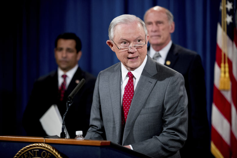 Attorney General Jeff Sessions, accompanied by, from left, National Counterintelligence and Security Center Director William Evanina, Director of National Intelligence Dan Coats, speaks during a briefing at the Justice Department in Washington, Friday, Aug. 4, 2017, on leaks of classified material threatening national security, one week after President Donald Trump complained that Sessions was weak on preventing such disclosures. (AP Andrew Harnik)