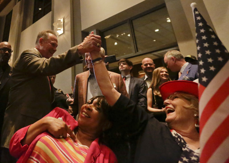 Former Alabama Chief Justice and U.S. Senate candidate Roy Moore, greets supporter Patricia Jones, right, before his election party, Tuesday, Sept. 26, 2017, in Montgomery, Ala.(AP Photo/Brynn Anderson)