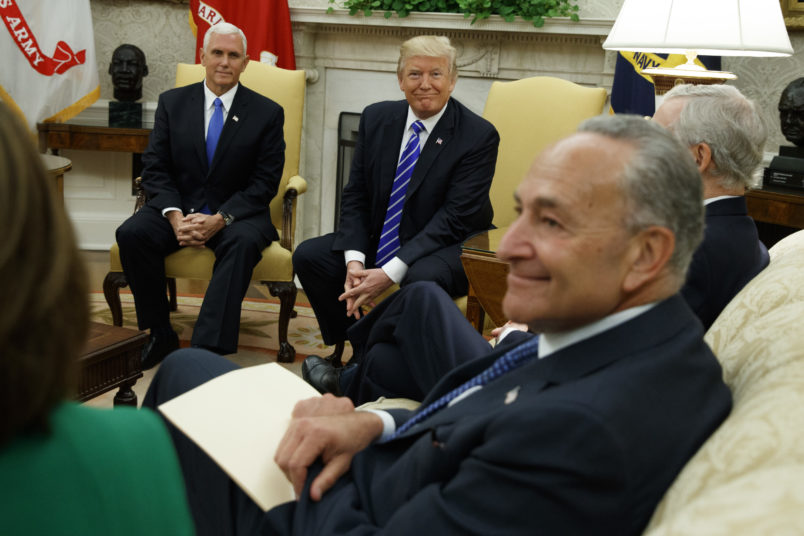 Vice President Mike Pence looks on as President Donald Trump speaks during a meeting with Senate Minority Leader Chuck Schumer, D-N.Y., and other Congressional leaders in the Oval Office of the White House, Wednesday, Sept. 6, 2017, in Washington. (AP Photo/Evan Vucci)