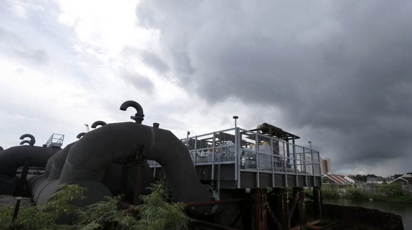 FILE -In this Thursday, Aug. 10, 2017 file photo, rain clouds gather over the 17th Street Canal pumping station in New Orleans.  Flood-weary New Orleans braced Thursday for the weekend arrival of Tropical Storm Nate, forecast to hit the area Sunday morning as a weak hurricane that could further test a city drainage system in which weaknesses were exposed during summer deluges.(AP Photo/Gerald Herbert, File)