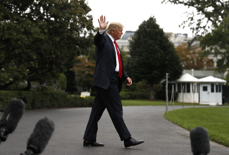 President Donald Trump waves as he walks to board  Marine One helicopter on the South Lawn of the White House in Washington, Wednesday, Oct. 11, 2017, for a short trip to Andrews Air Force Base, Md., and then onto Harrisburg, Pa. (AP Photo/Carolyn Kaster)