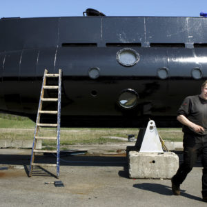 FILE - The Danish navy says it is searching for a nearly 18-meter-long (59.4-feet), 40-ton privately built submarine in the waters off Copenhagen with at least two people onboard. The submarine and the owner Peter Madsen is seen in this April 30 2008 file photo. (Niels Hougaard/AP via Ritzau FILE)  DENMARK OUT