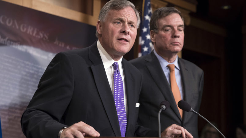Senate Select Committee on Intelligence Chairman Richard Burr, R-N.C., left, and Vice Chairman Mark Warner, D-Va., update reporters on the status of their inquiry into Russian interference in the 2016 U.S. elections, at the Capitol in Washington, Wednesday, Oct. 4, 2017. Burr says the committee has interviewed more than 100 witnesses as part of its investigation and that more work still needs to be done.  (AP Photo/J. Scott Applewhite)