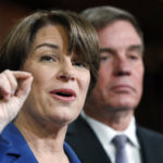 Sen. Amy Klobuchar, D-Minn., left, and Sen. Mark Warner, D-Va., speak about online political ads and preventing foreign interference in U.S. elections, during a news conference, Thursday, Oct. 19, 2017, on Capitol Hill in Washington. (AP Photo/Jacquelyn Martin)
