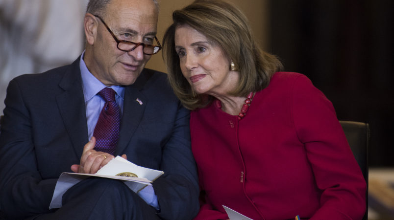UNITED STATES - OCTOBER 25: Senate Minority Leader Charles Schumer, D-N.Y., and House Minority Leader Nancy Pelosi, D-Calif., attend a Congressional Gold Medal ceremony in in Emancipation Hall to honor Filipino veterans of World War II on October 25, 2017. (Photo By Tom Williams/CQ Roll Call)