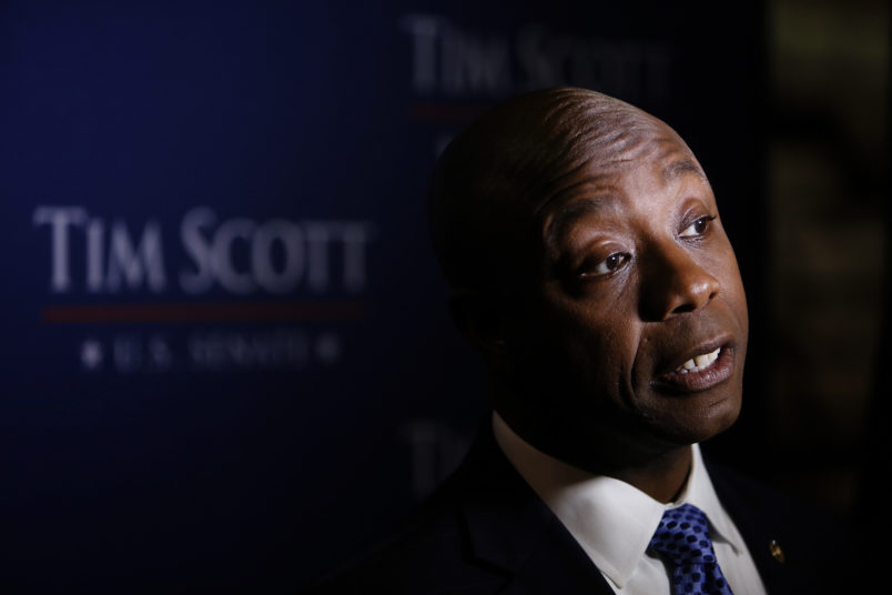 U.S. Sen. Tim Scott, R-S.C., holds a news conference after winning his Senate race against Democratic challenger Thomas A. Dixon at the North Charleston Performing Arts Center in North Charleston, S.C. Tuesday, Nov. 8, 2016. (AP Photo/Mic Smith)