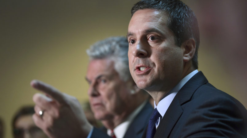 House Intelligence committee Chairman Rep. Devin Nunes, R-Calif., right, standing with Rep. Peter King, R-N.Y., left, speaks on Capitol Hill in Washington, Tuesday, Oct. 24, 2017. (AP Photo/Susan Walsh)