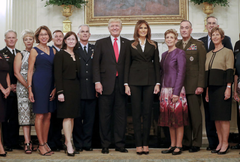 President Donald Trump and first lady Melania Trump, center, poses for a group photo with Senior Military leaders and spouses in the State Dining Room of the White House in Washington, Thursday, Oct. 5, 2017. Trump was hosting the dinner for the group this evening. (AP Photo/Pablo Martinez Monsivais)