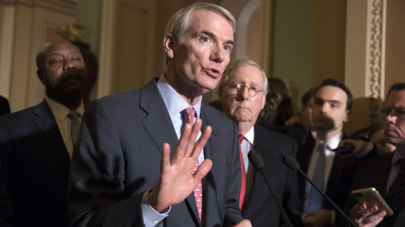 Sen. Rob Portman, R-Ohio, a member of the Senate Finance Committee, joins Sen.Tim Scott, R-S.C., left, and Majority Leader Mitch McConnell, R-Ky., to talk about work on overhauling the nation's tax code, on Capitol Hill in Washington, Tuesday, Nov. 14, 2017. (AP Photo/J. Scott Applewhite)