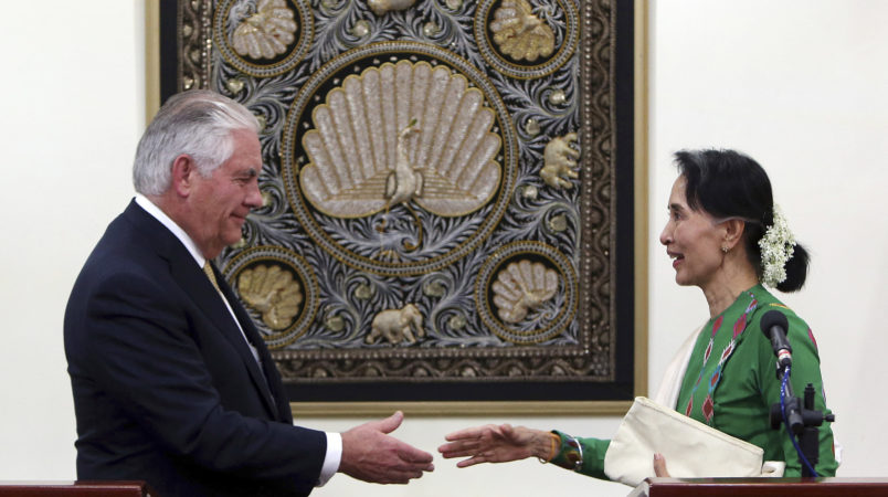 Myanmar Foreign Minister Aung San Suu Kyi, right, shakes hands with US Secretary of State Rex Tillerson, left, after their press conference at the Foreign Ministry office in Naypyitaw, Myanmar, Wednesday, Nov. 15, 2017. (AP Photo/Aung Shine Oo)