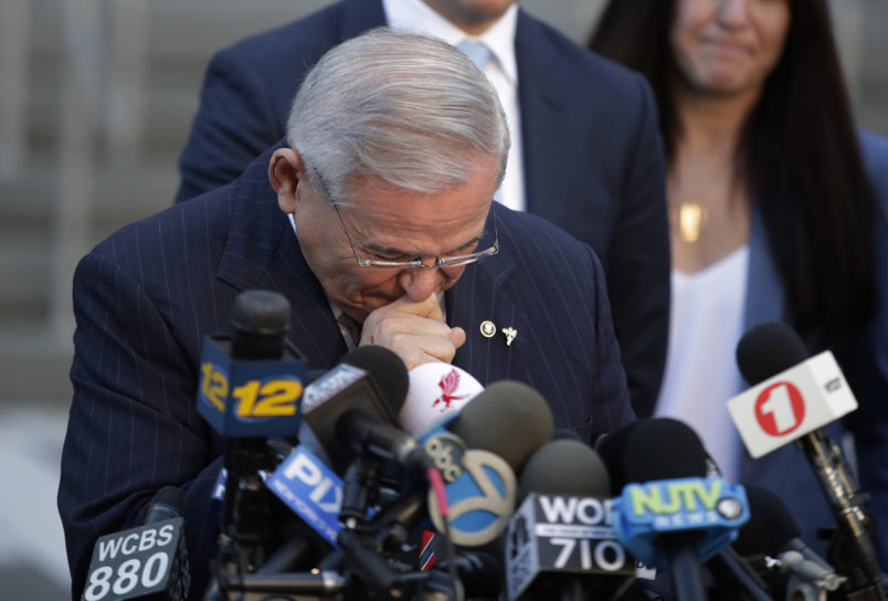 U.S. Sen. Bob Menendez fights tears as he speaks to reporters outside Martin Luther King Jr. Federal Courthouse after U.S. District Judge William H. Walls declared a mistrial in Menendez' federal corruption trial, Thursday, Nov. 16, 2017, in Newark, N.J. (AP Photo/Julio Cortez)